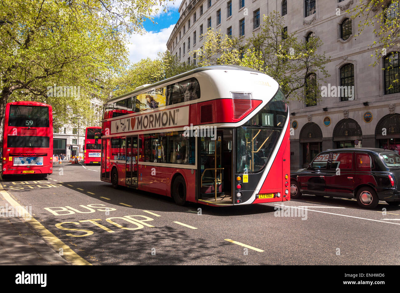 Buses on Aldwych in London UK including New Routemaster hybrid bus centre - Stock Image