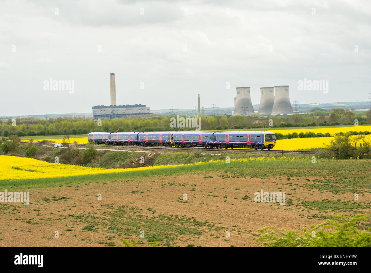 With the remains of the now extinct Didcot Power Station providing the backdrop, a pair of First Great Western turbo - Stock Image