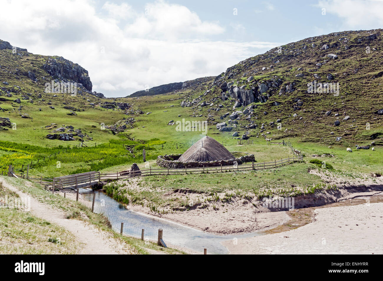 Reconstructed Iron Age House at Bostadh beach on the west coast of the Isle of Lewis in the Outer Hebrides Scotland - Stock Image