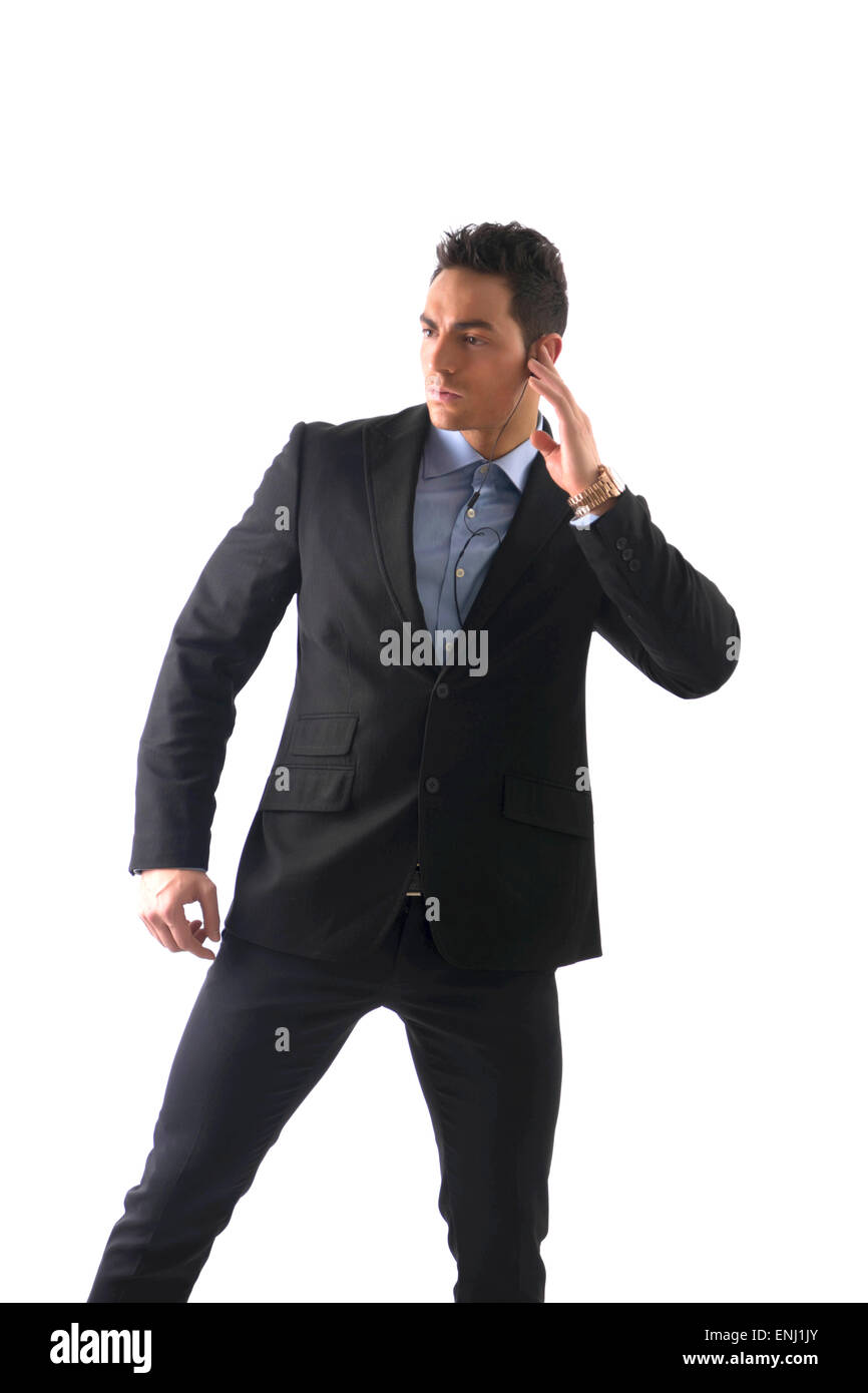 Elegant man ressed as bodyguard or security agent - Stock Image