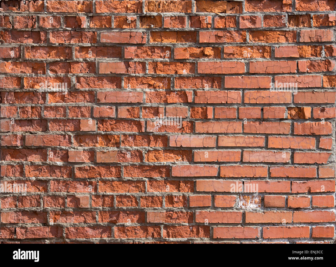 cracked worn red brick wall background Stock Photo