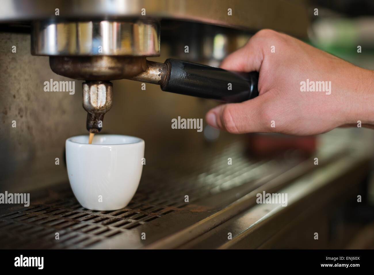 Barista pulling espresso shot-close-up - Stock Image