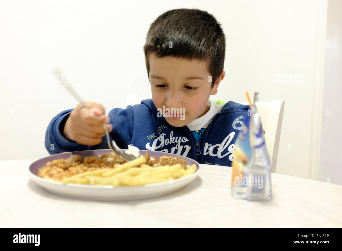 Child eating  fry-up meal - Stock Image