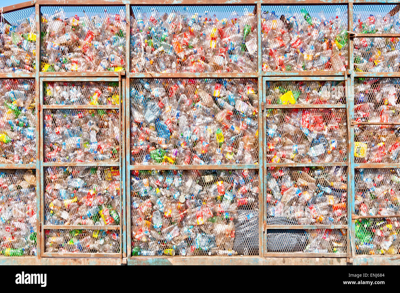 Isla Mujeres, Mexico - April 24, 2014: plastic bottles lie in a heap in a metal cage on a truck in Isla Mujeres, - Stock Image