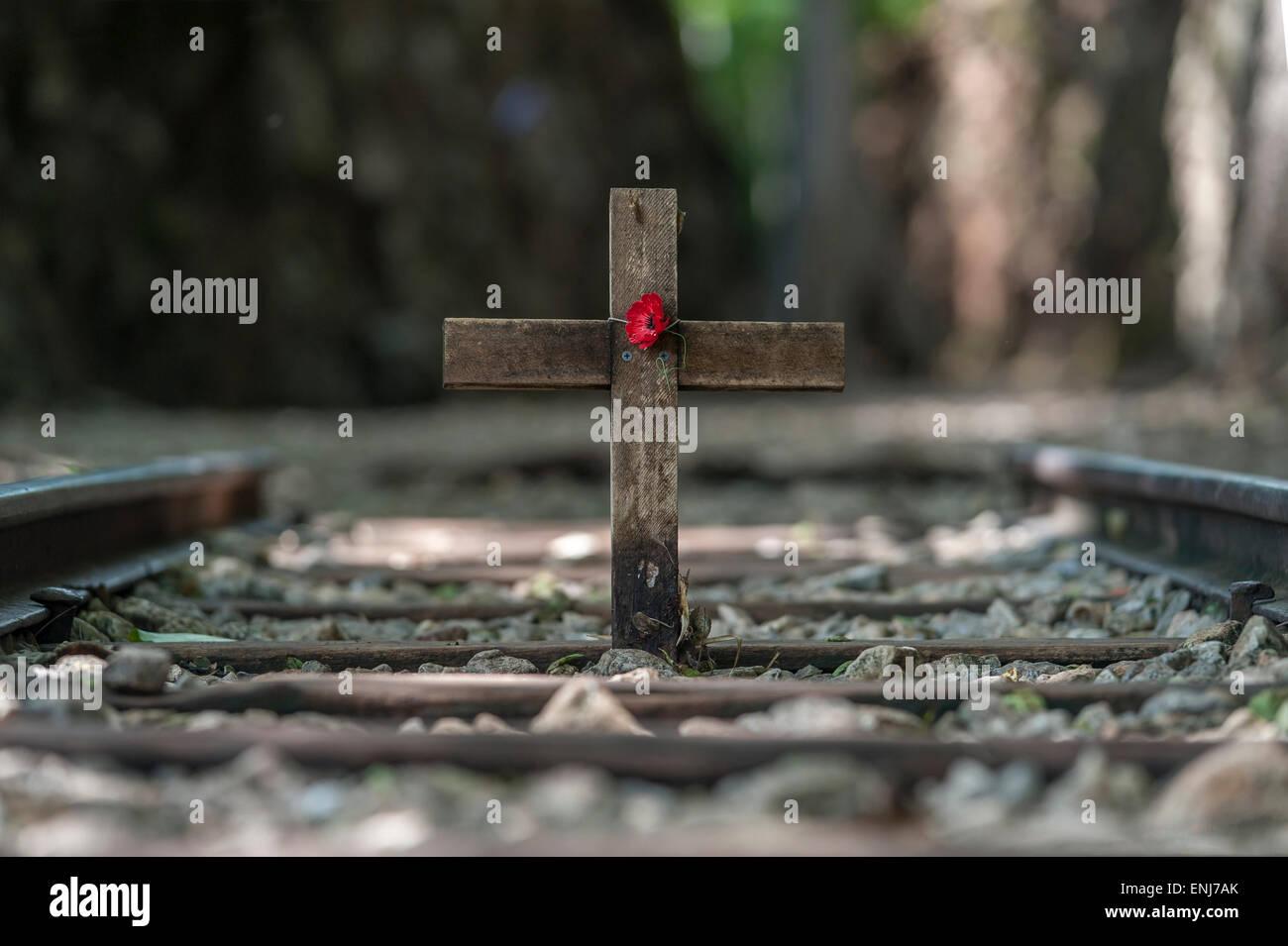Remembrance cross and poppy at Hellfire Pass along the Burma Railway (Death Railway) Tenasserim Hills. Thailand - Stock Image