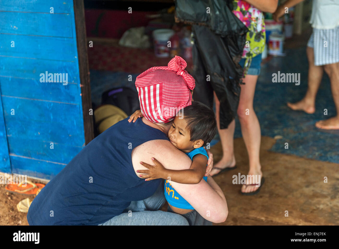 Tourist volunteers saying goodbyes to the children at the Dream House orphanage & children's home. Sangklaburi. - Stock Image