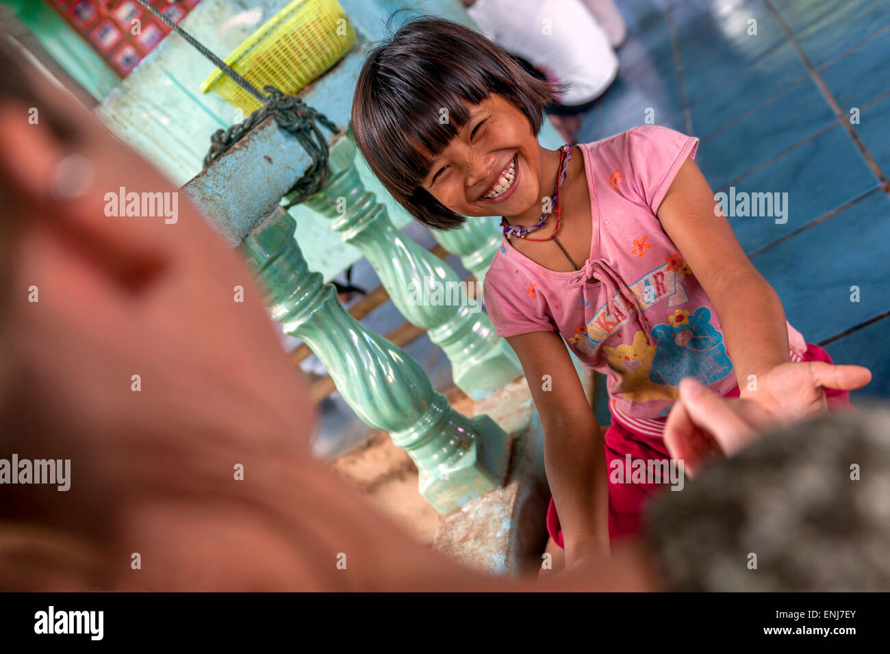 A volunteer student tourist playing with young girl at the Orphanage at Sangkhlaburi. Kanchanaburi. Thailand - Stock Image