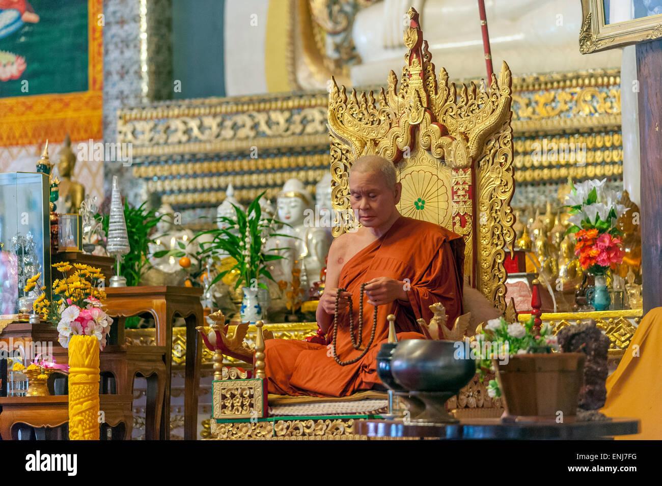 Wax figure of the late abbot Luangpho Uttama meditating at Wat Wang Wiwekaram temple, Mon Village, Sangkhlaburi, - Stock Image