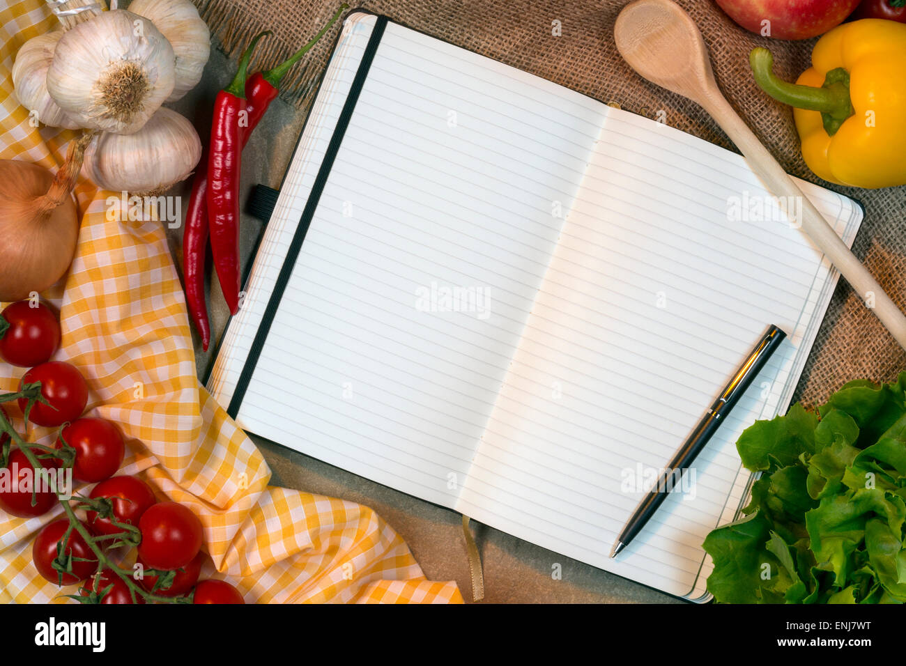 Blank recipe book pages (space for text) with cooking ingredients and utensils - Stock Image
