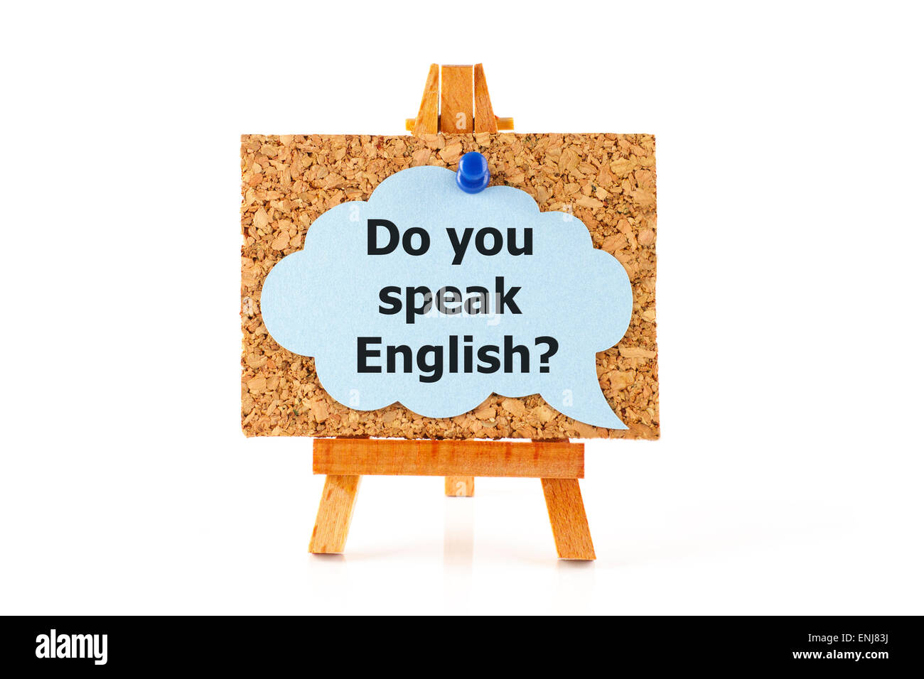 Wooden easel with corkboard and blue speech bubble with words Do you speak English? isolated on white background - Stock Image