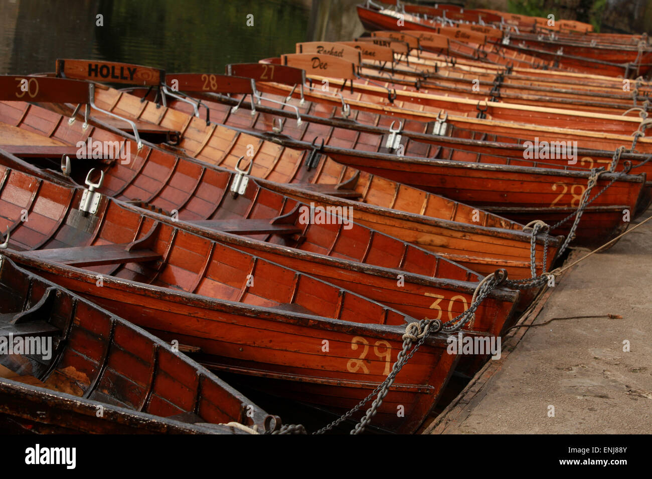 Classic wooden rowing boats on the River Wear by Elvet Bridge Durham UK - Stock Image