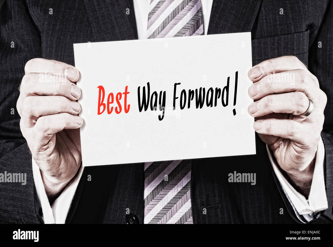 A businessman holding a card with the words, Keep best way Forward. - Stock Image