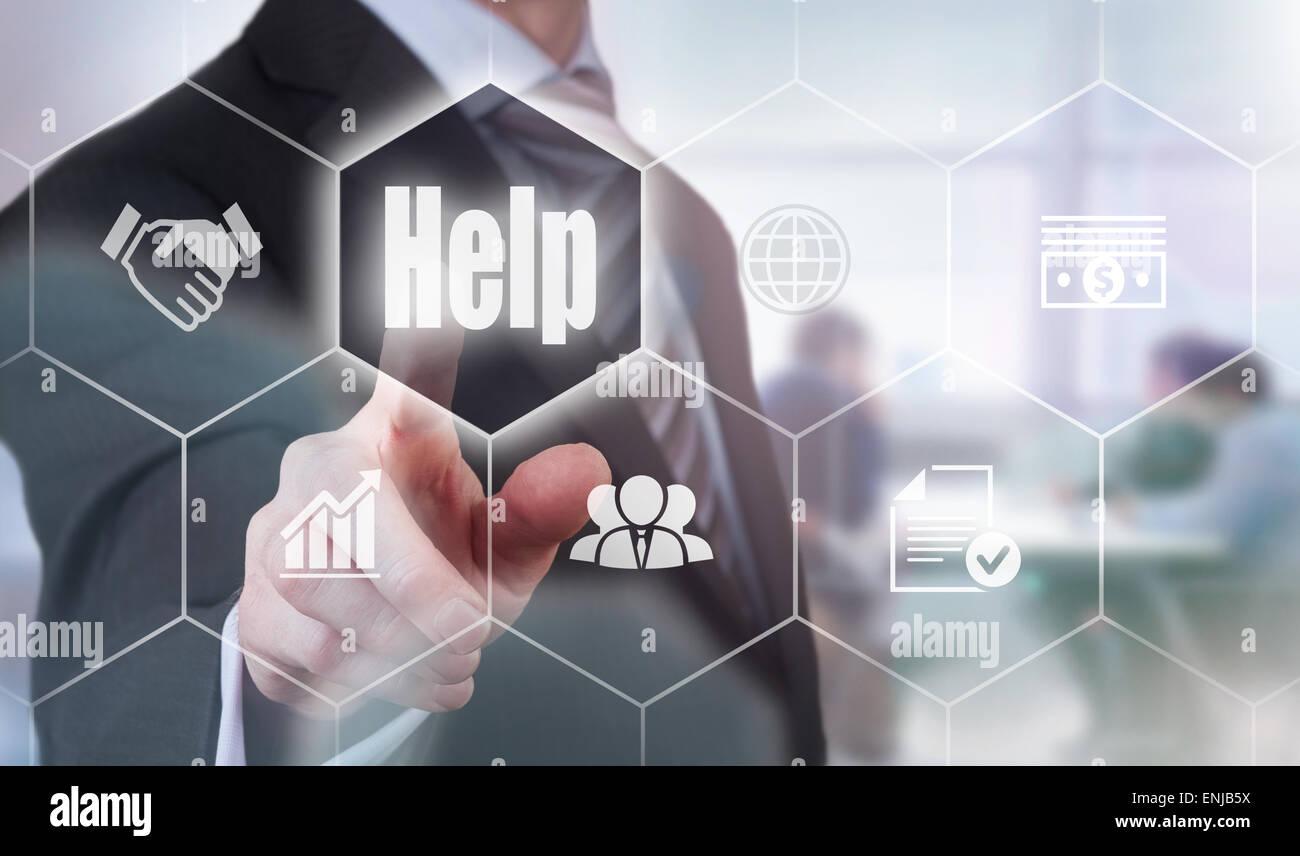 Businessman pressing an Help concept button. - Stock Image