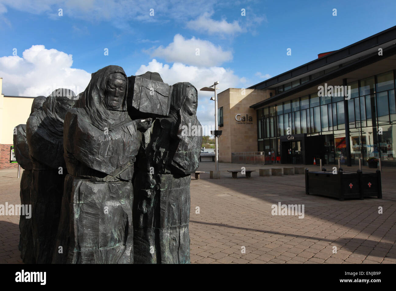 The Journey sculpture by Fenwick Lawson, monks carriyng the coffin of St Cuthbert,  in Millennium Place in Durham - Stock Image