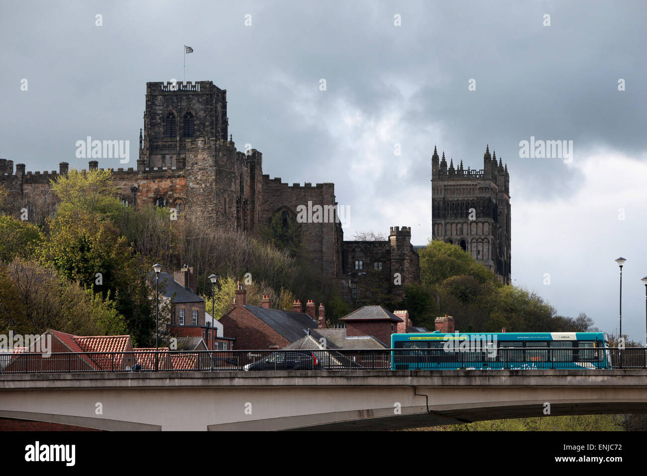 A bus driving though Durham with Durham Cathedral and Durham Castle in the background - Stock Image