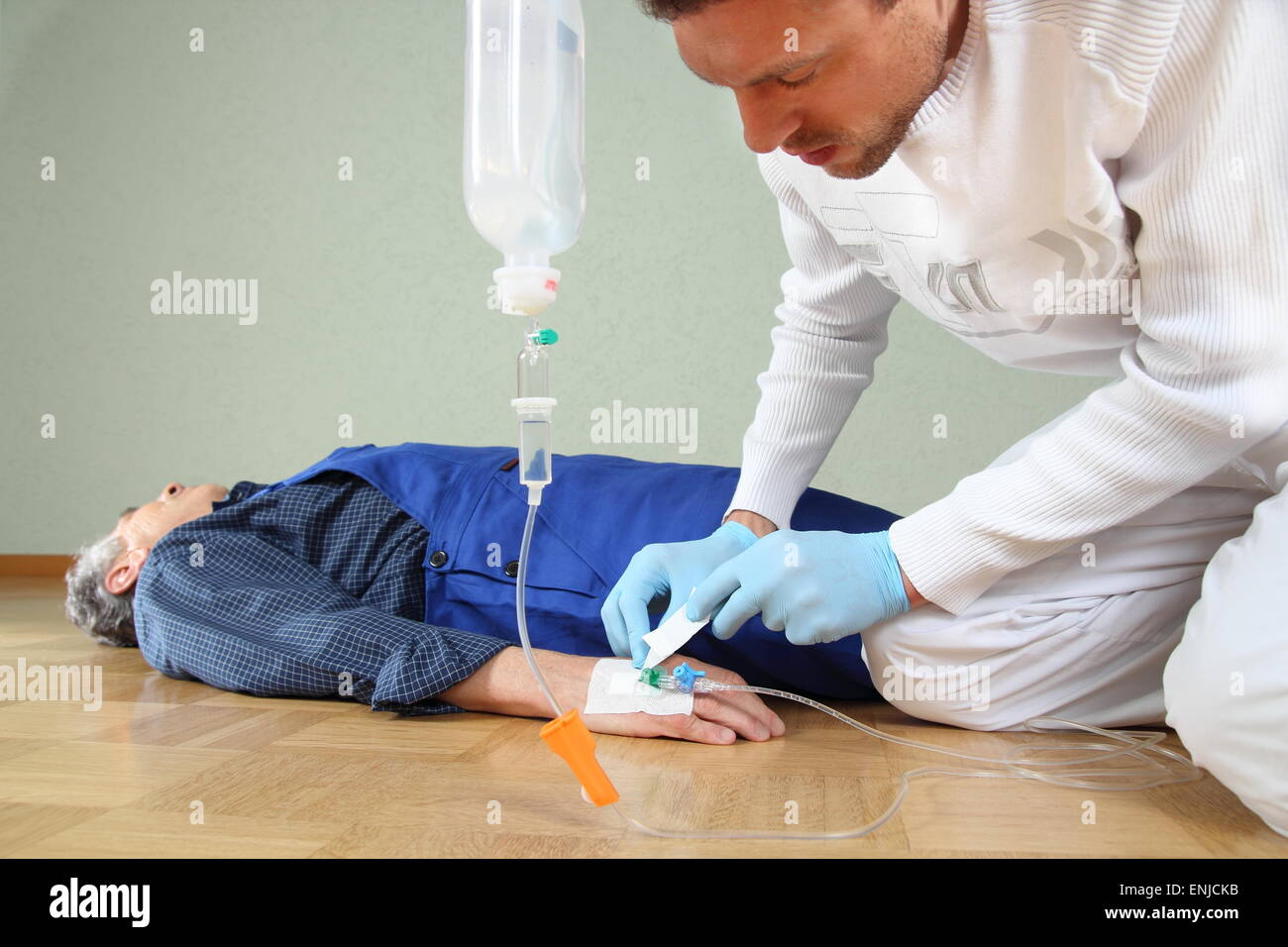 A Infusion of a patient by a paramedic - Stock Image