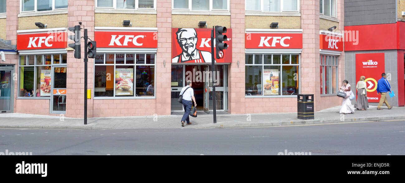 Kentucky Fried Chicken wide frontage on road junction corner site partly on East Ham high street East Ham Newham - Stock Image