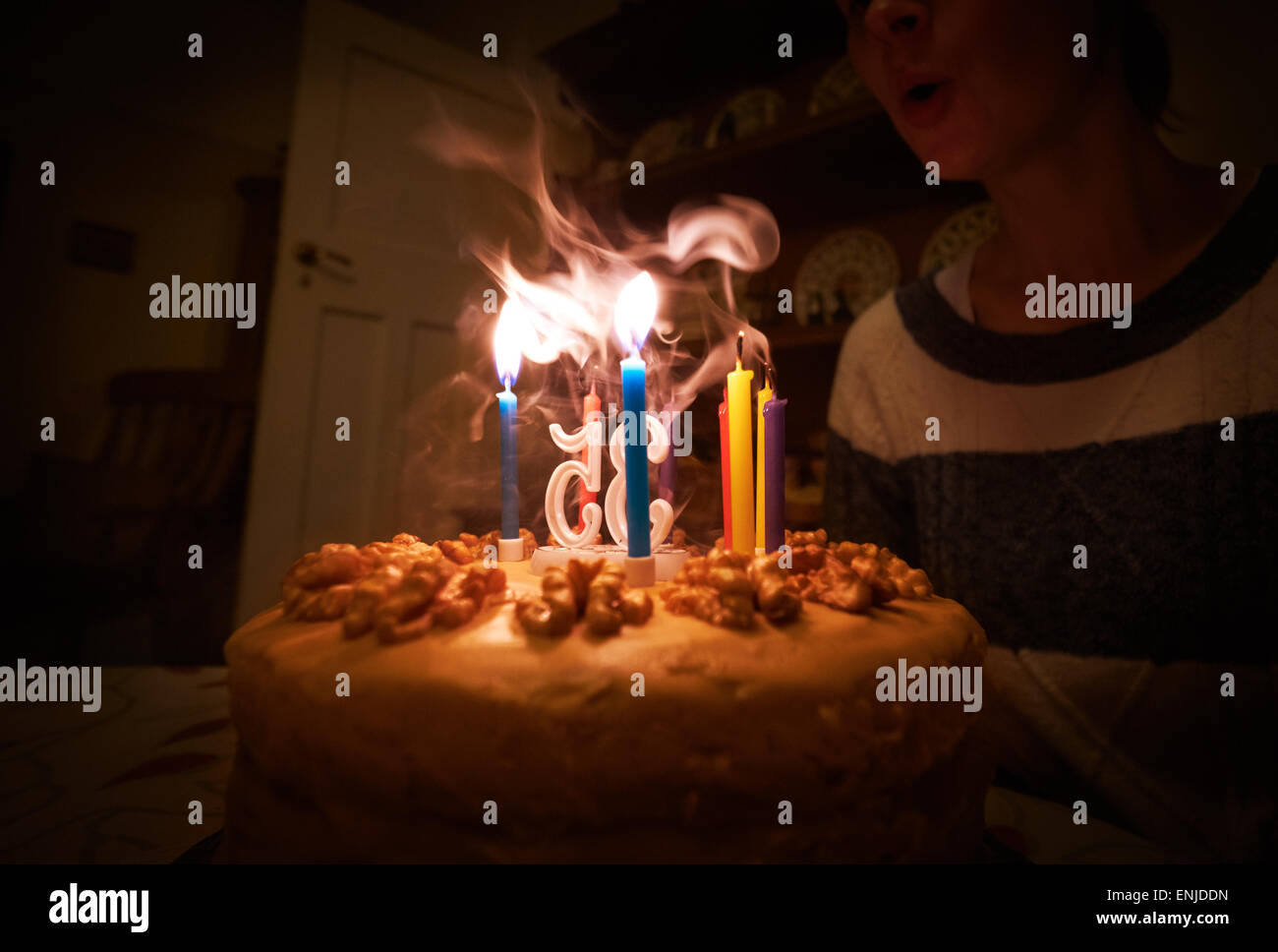 A Woman Blowing Out Candles On Her Birthday Cake Instagram Type