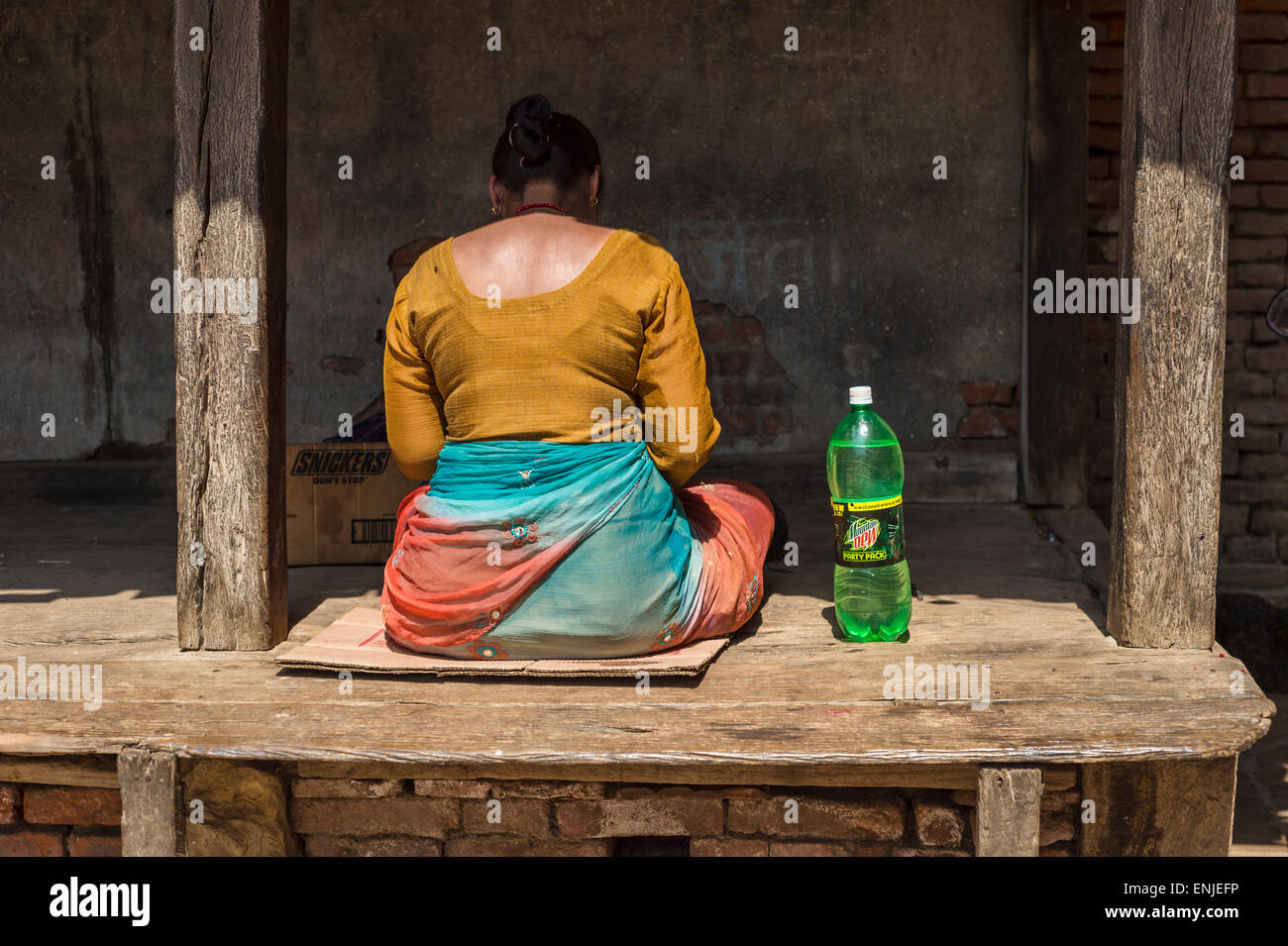 Back of a knitting woman in Bhaktapur, Nepal Stock Photo