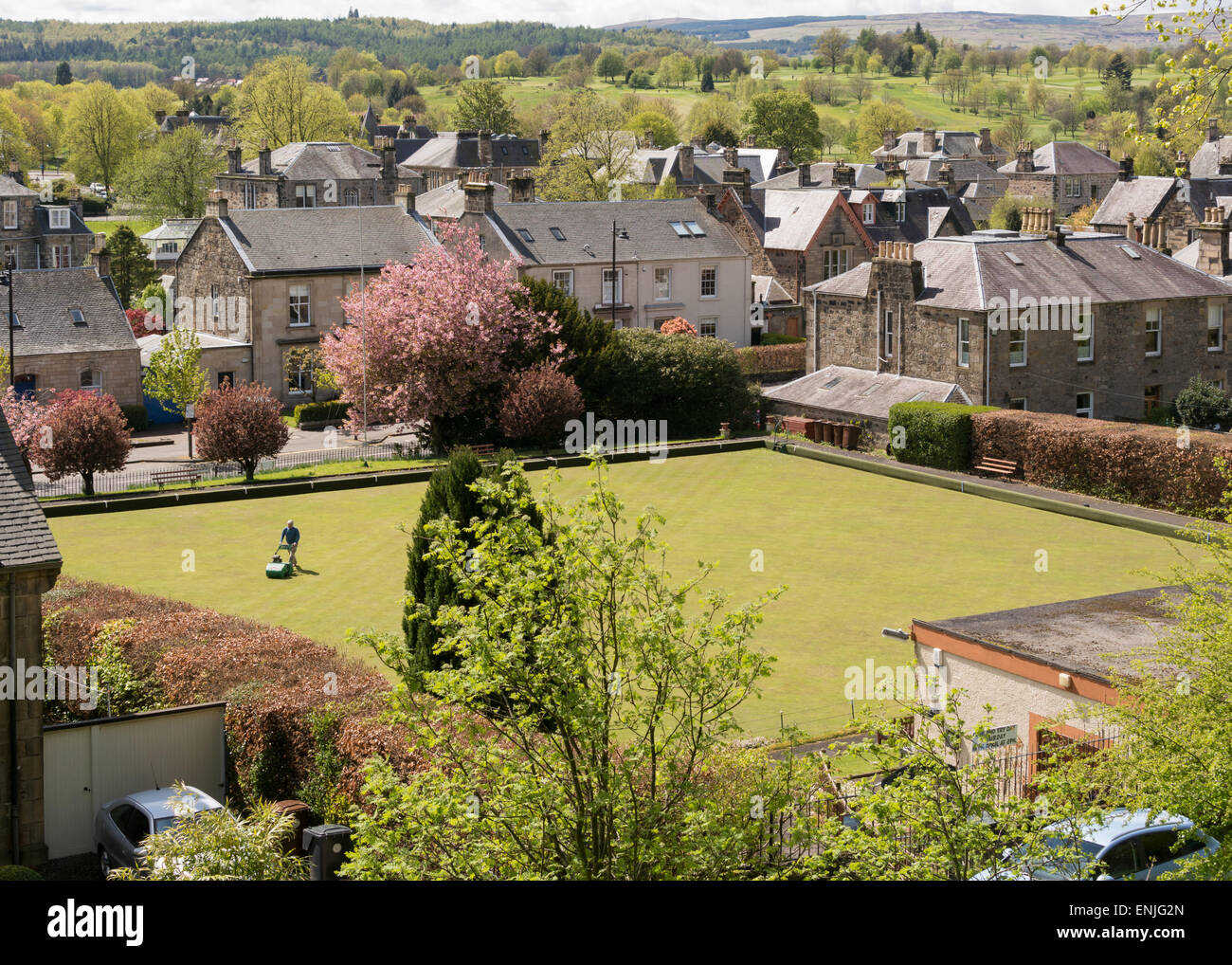 Spring in the city of Stirling - mowing the bowling green - Stock Image
