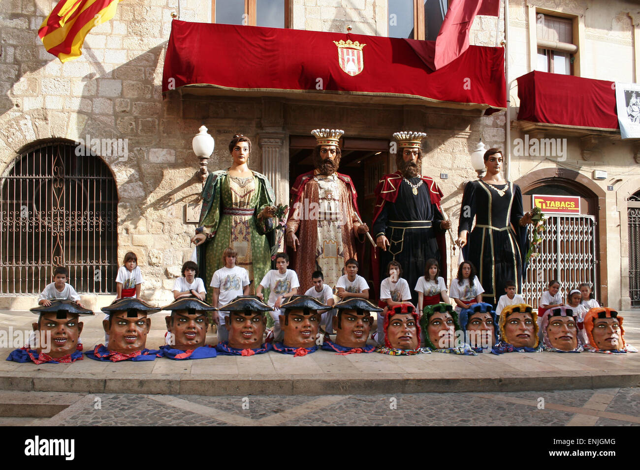 Giants,large-headed dwarfs,donkeys,eagles and dragons dancing at the popular festivities in the medieval village Stock Photo