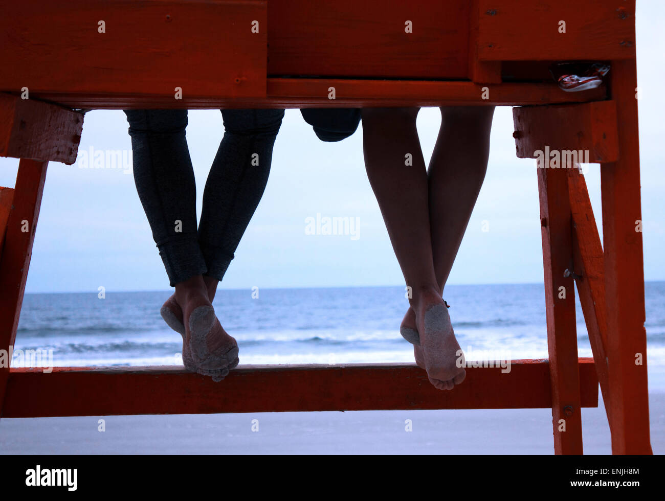 Two girls sitting on a life saver watcher seat,  at Jacksonville beach - Stock Image