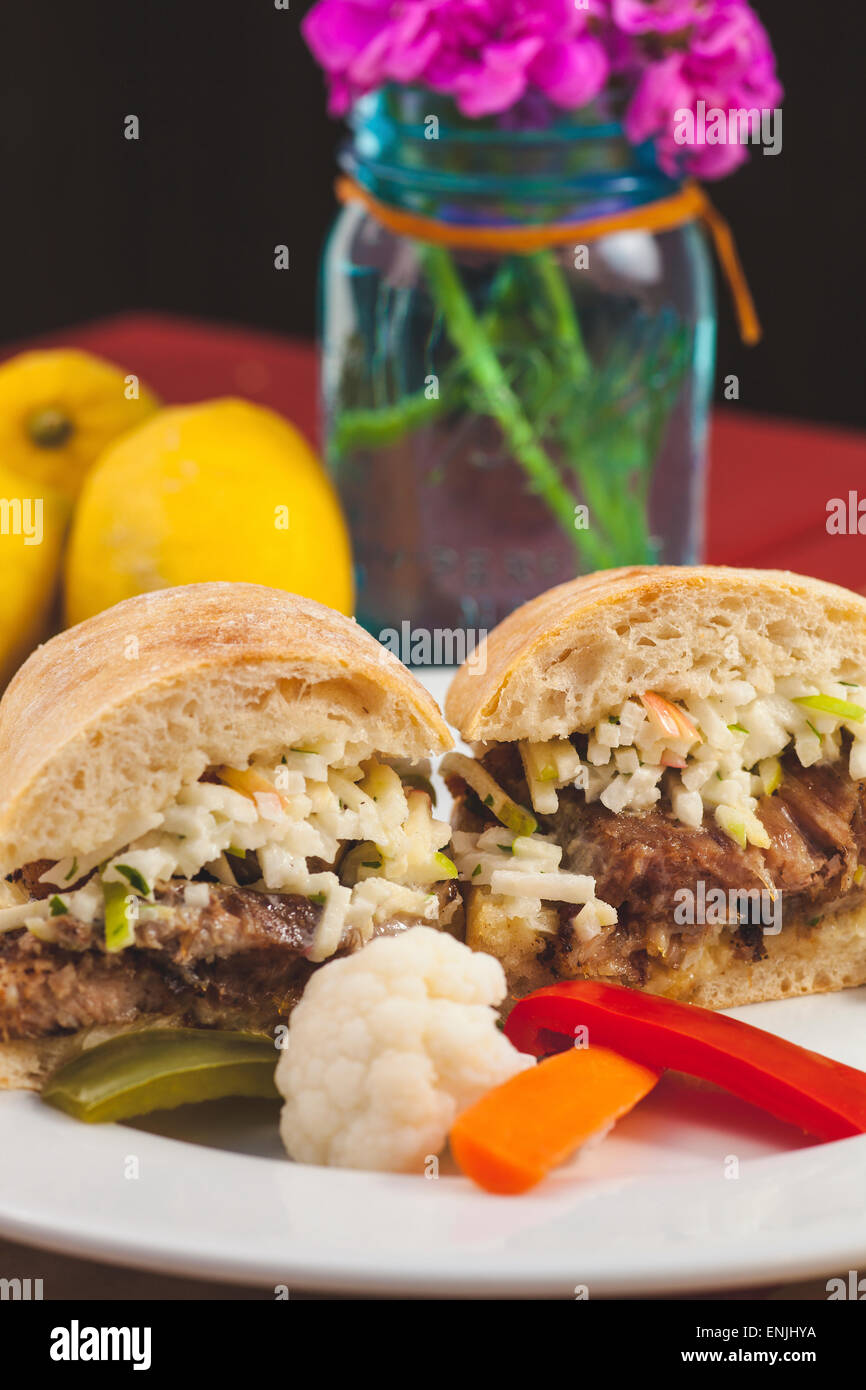 crispy rotisserie pork sandwich with pickled vegetables, Bell Street Farm deli, Los Alamos, California - Stock Image