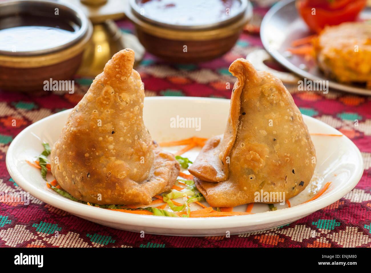 Himalayan samosas, sauces and aloo tikka, Himalaya Restaurant, Cuisine of Nepal, India and Tibet, Ventura, California - Stock Image