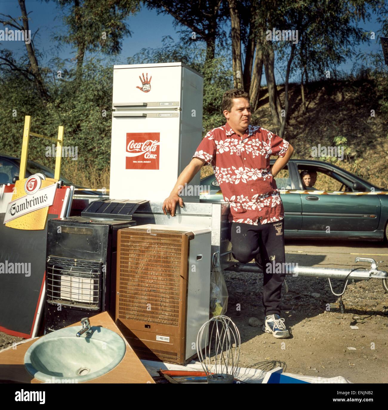 Salesman and used appliances offer on Market, Prague Czech Republic - Stock Image