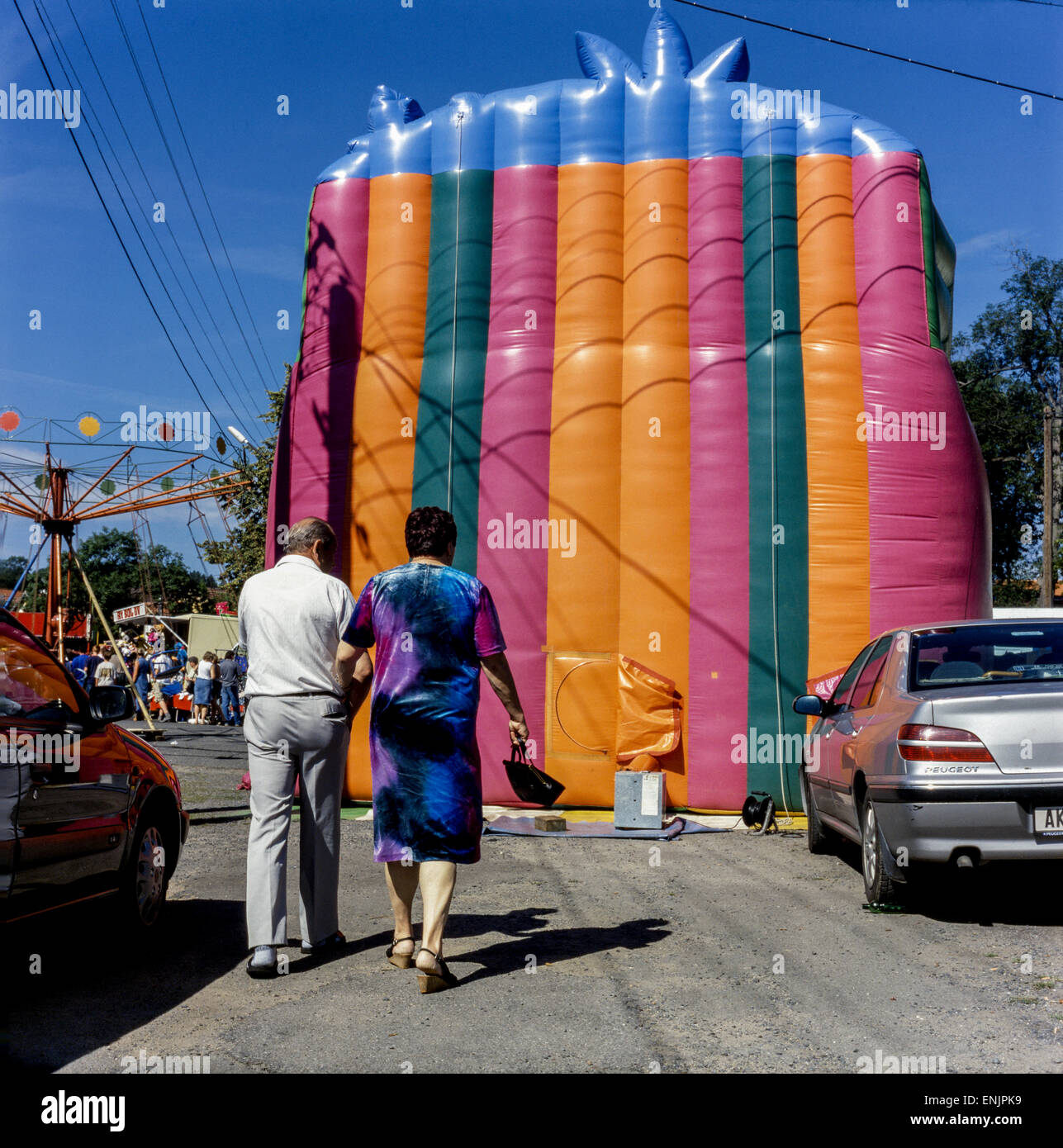 rural fair, couple, mimicry, inflatable bouncy castle couple pair - Stock Image