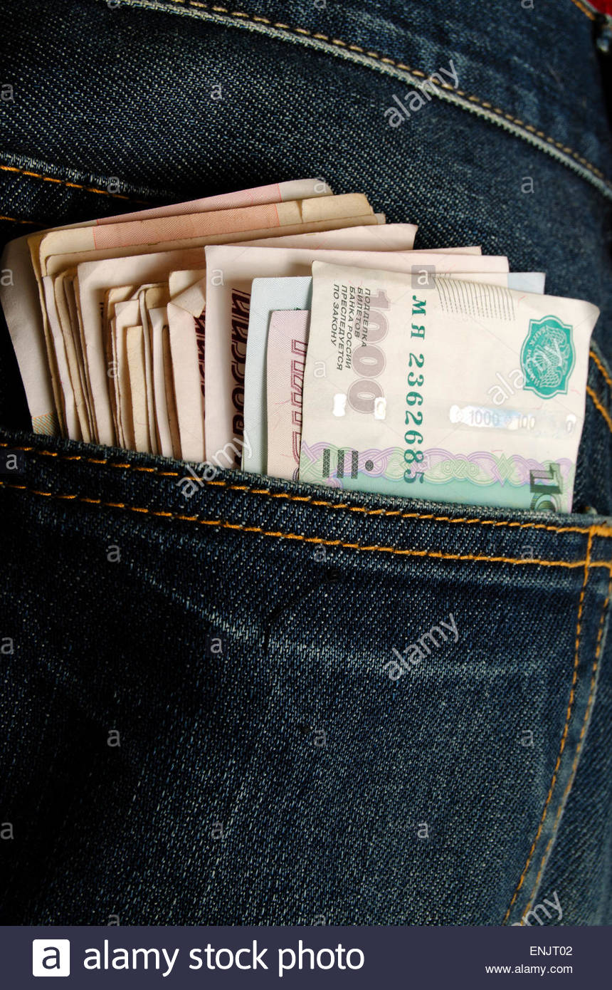Money in the pocket of blue jeans. - Stock Image