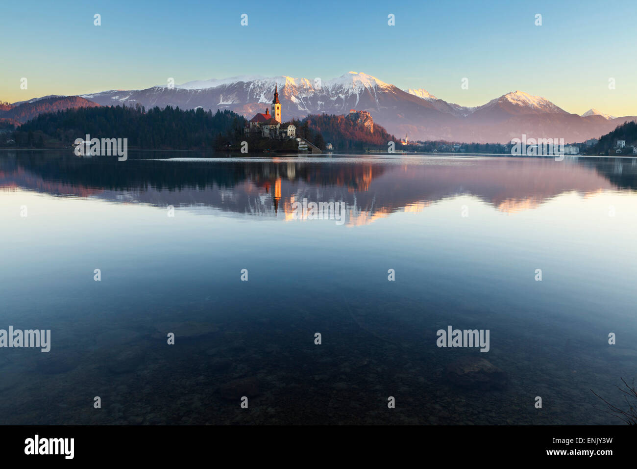 The Assumption of Mary Pilgrimage Church on Lake Bled and Bled Castle, Bled, Slovenia, Europe - Stock Image