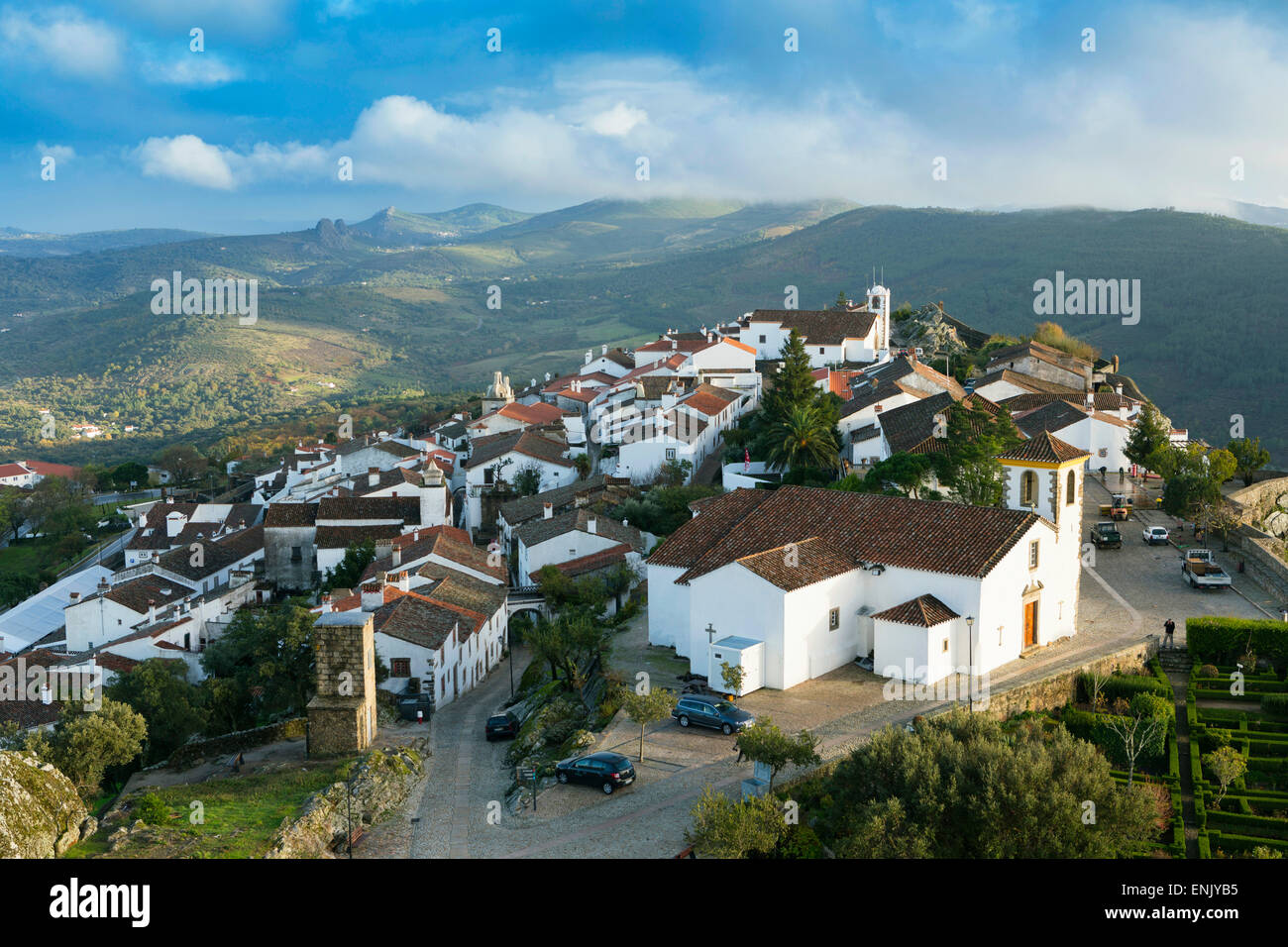 The 15th century parish church and medieval town castle with the Serra de Sao Mamede mountains, Marvao, Alentejo, - Stock Image