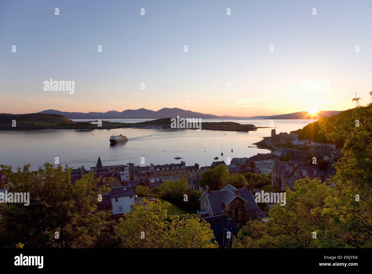 View over Oban Bay from McCaig's Tower, sunset, ferry coming into port, Oban, Argyll and Bute, Scotland, United Stock Photo