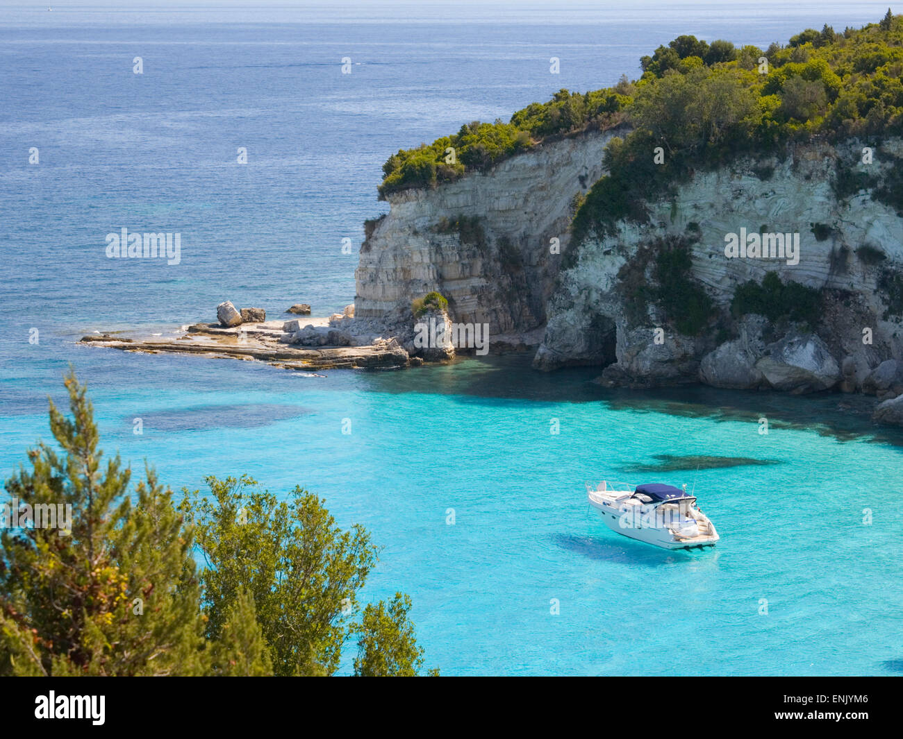 View from hillside over secluded Voutoumi Bay, solitary boat at anchor, Antipaxos, Paxi, Corfu, Ionian Islands, - Stock Image