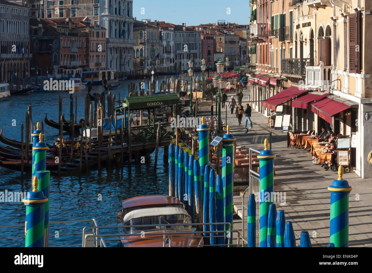 Green and blue mooring poles at the Rialto Bridge, Grand Canal, Venice, UNESCO World Heritage Site, Veneto, Italy, - Stock Image