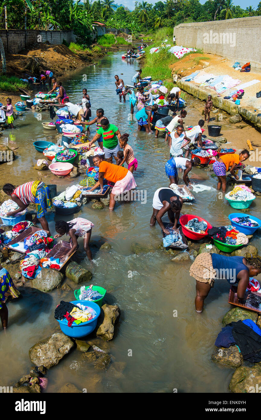 Women washing clothes in a river bed, City of Sao Tome, Sao Tome and Principe, Atlantic Ocean, Africa - Stock Image