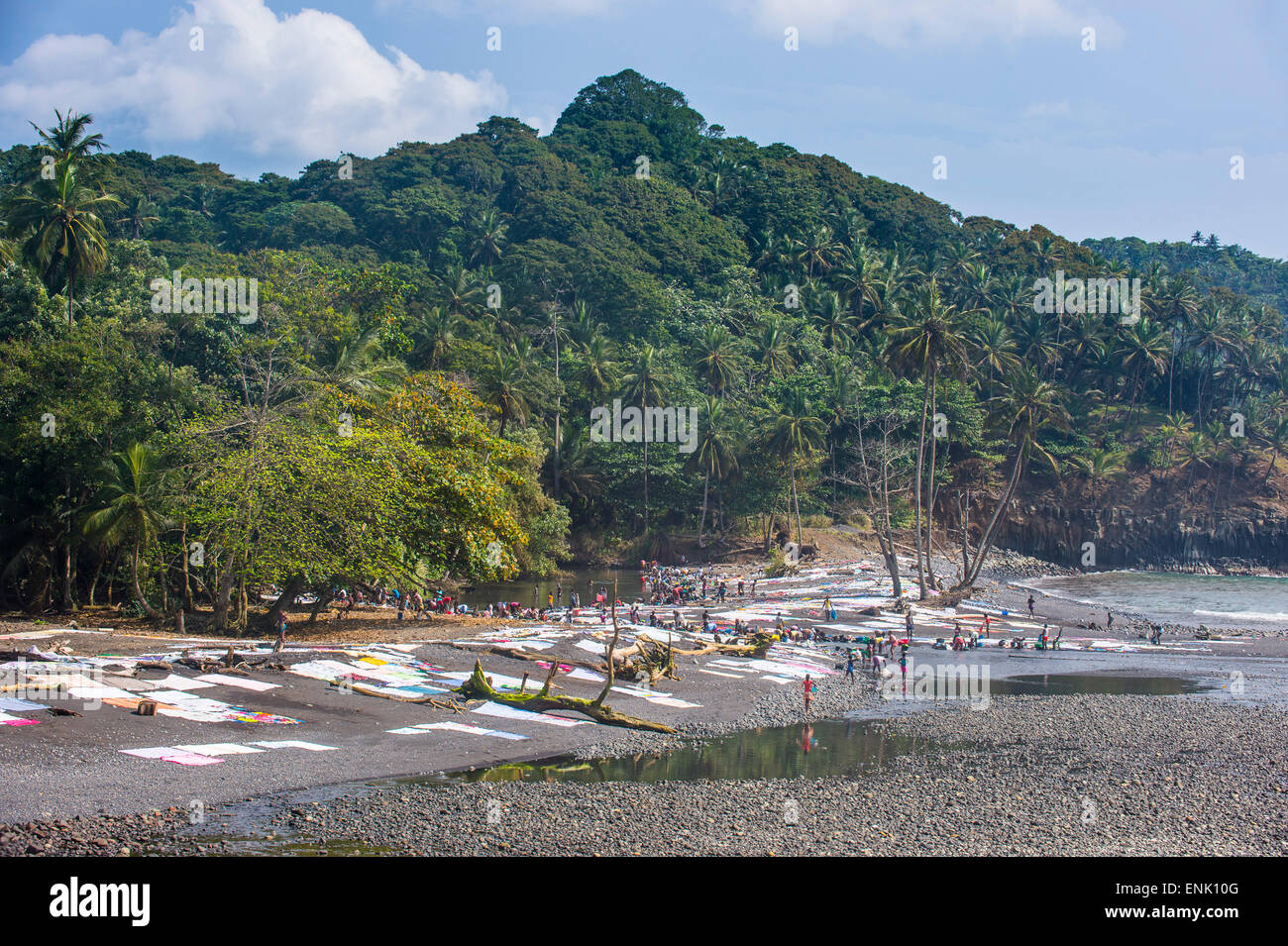 Wet clothes drying on a rocky beach, east coast of Sao Tome, Sao Tome and Principe, Atlantic Ocean, Africa - Stock Image