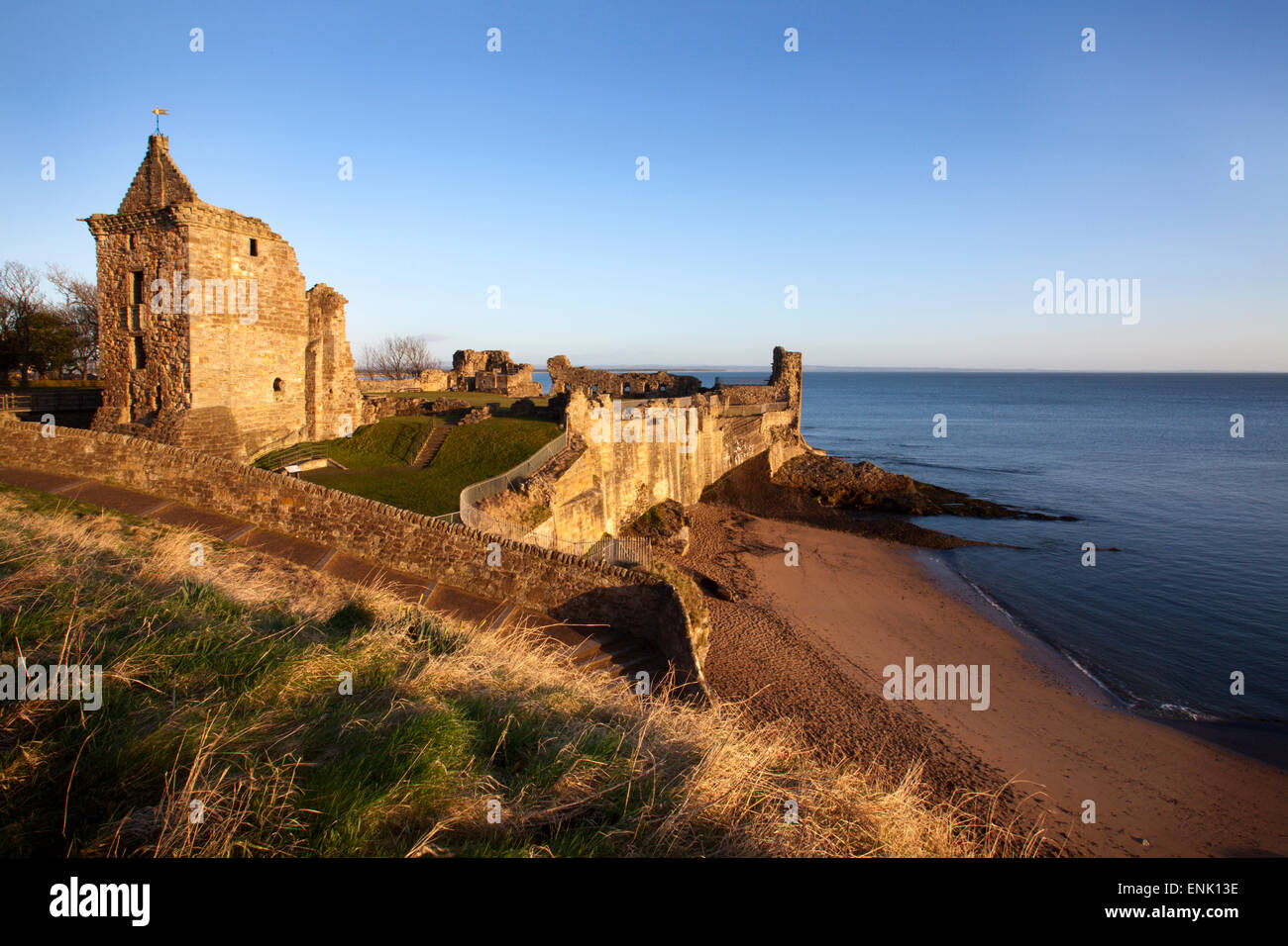 St. Andrews Castle and Castle Sands from The Scores at sunrise, Fife, Scotland, United Kingdom, Europe - Stock Image
