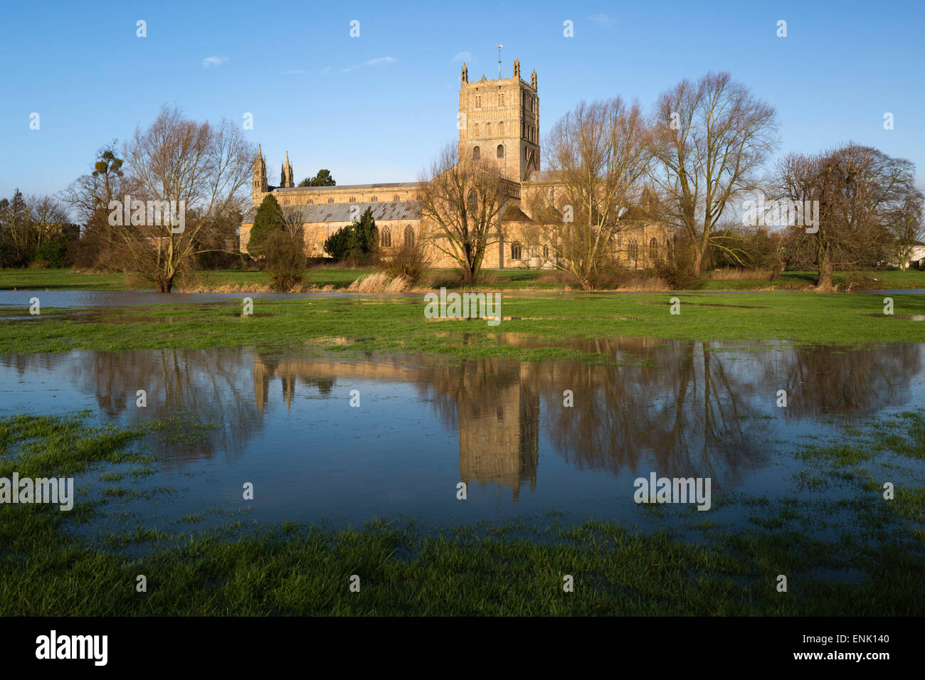Tewkesbury Abbey reflected in flooded meadow, Tewkesbury, Gloucestershire, England, United Kingdom, Europe - Stock Image