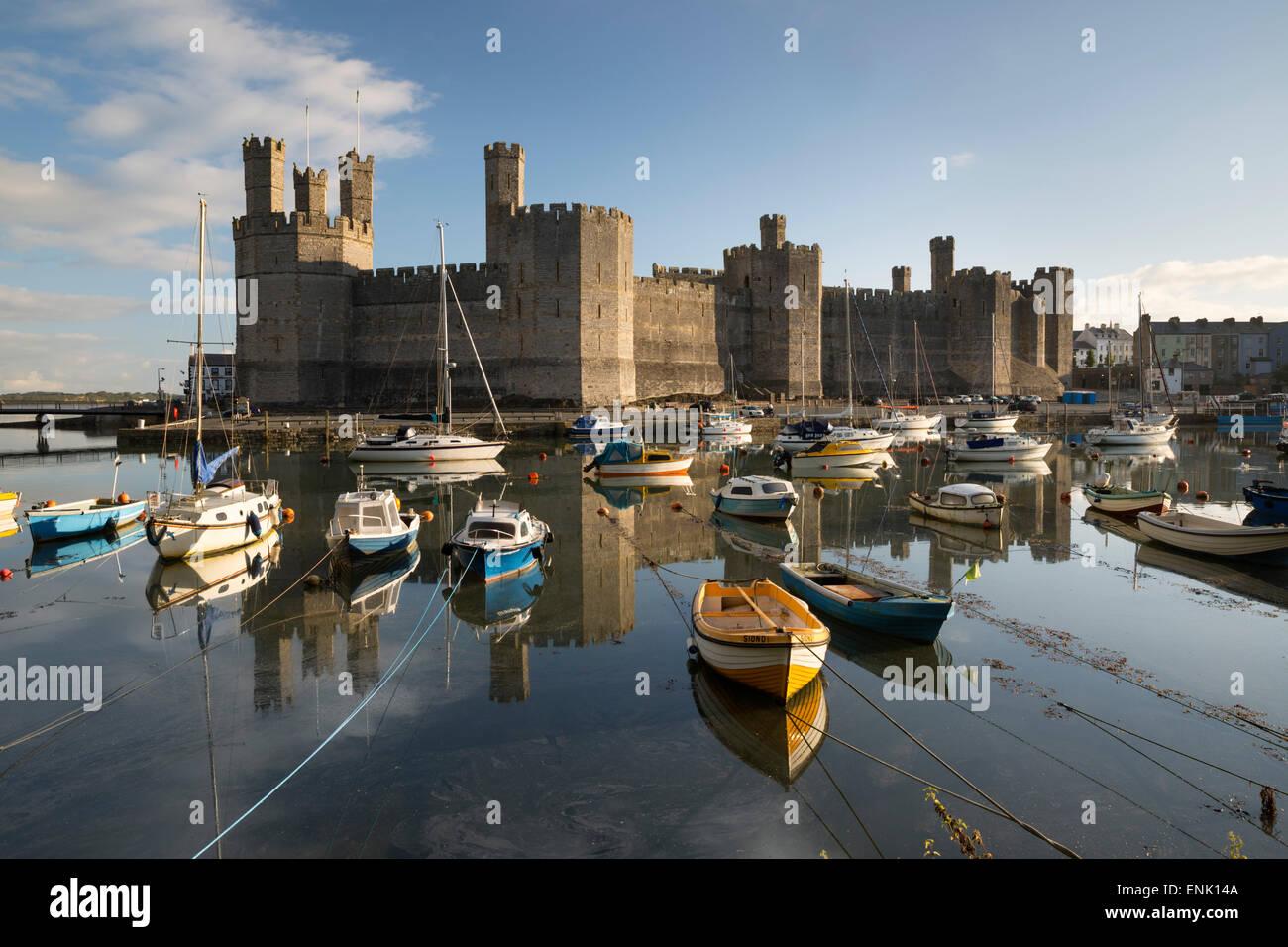 Caernarfon Castle,UNESCO World Heritage Site, on the River Seiont, Caernarfon, Snowdonia, Gwynedd, Wales, United - Stock Image