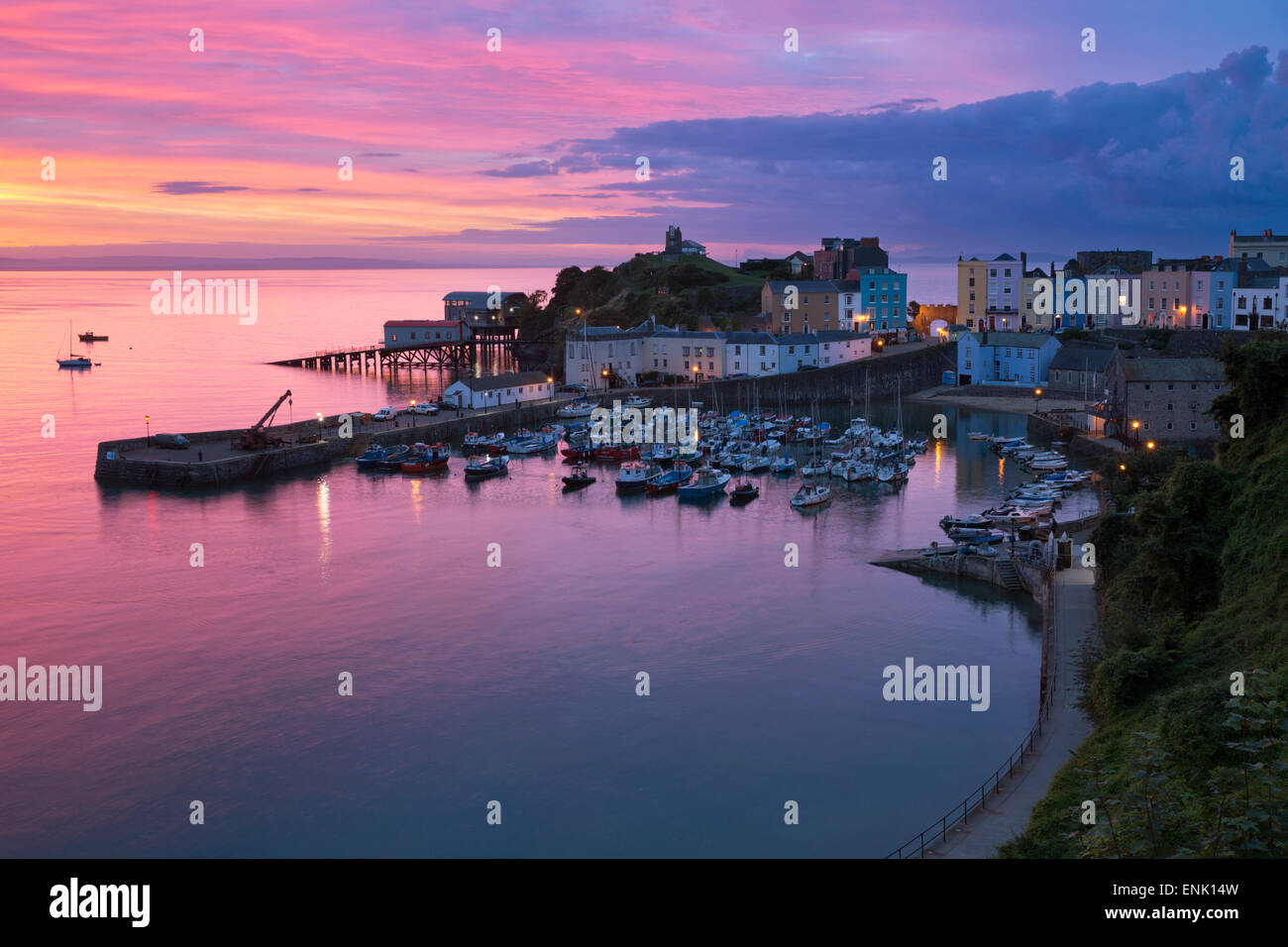 View over harbour and castle at dawn, Tenby, Carmarthen Bay, Pembrokeshire, Wales, United Kingdom, Europe - Stock Image