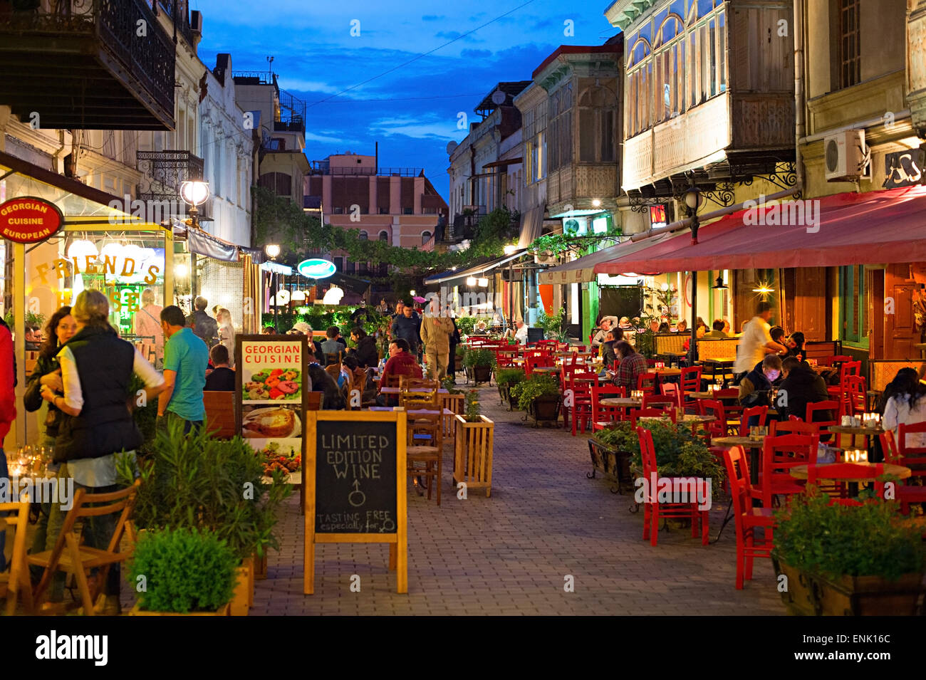 People at restaurant in the Old Town of Tbilisi. Tbiisi is the capital of Georgia and the large - Stock Image