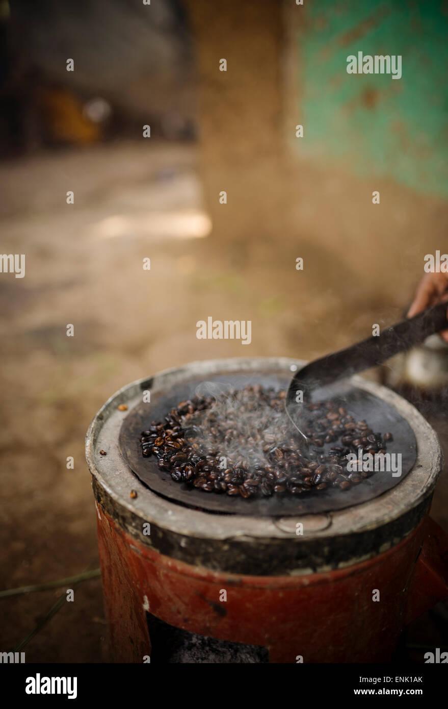 Freshly roasting coffee, Omorate, Omo Valley, Ethiopia, Africa - Stock Image