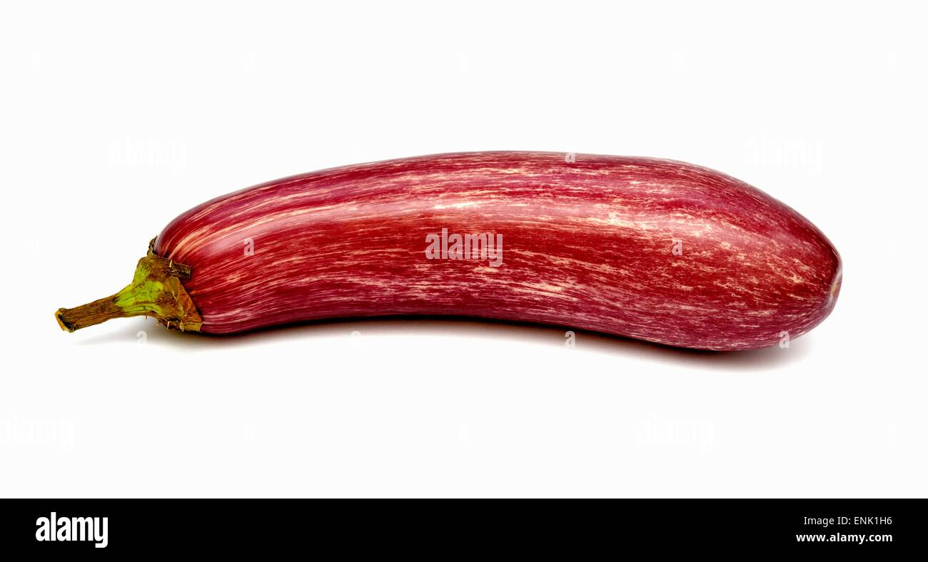 A  raw aubergine on a white studio background. - Stock Image