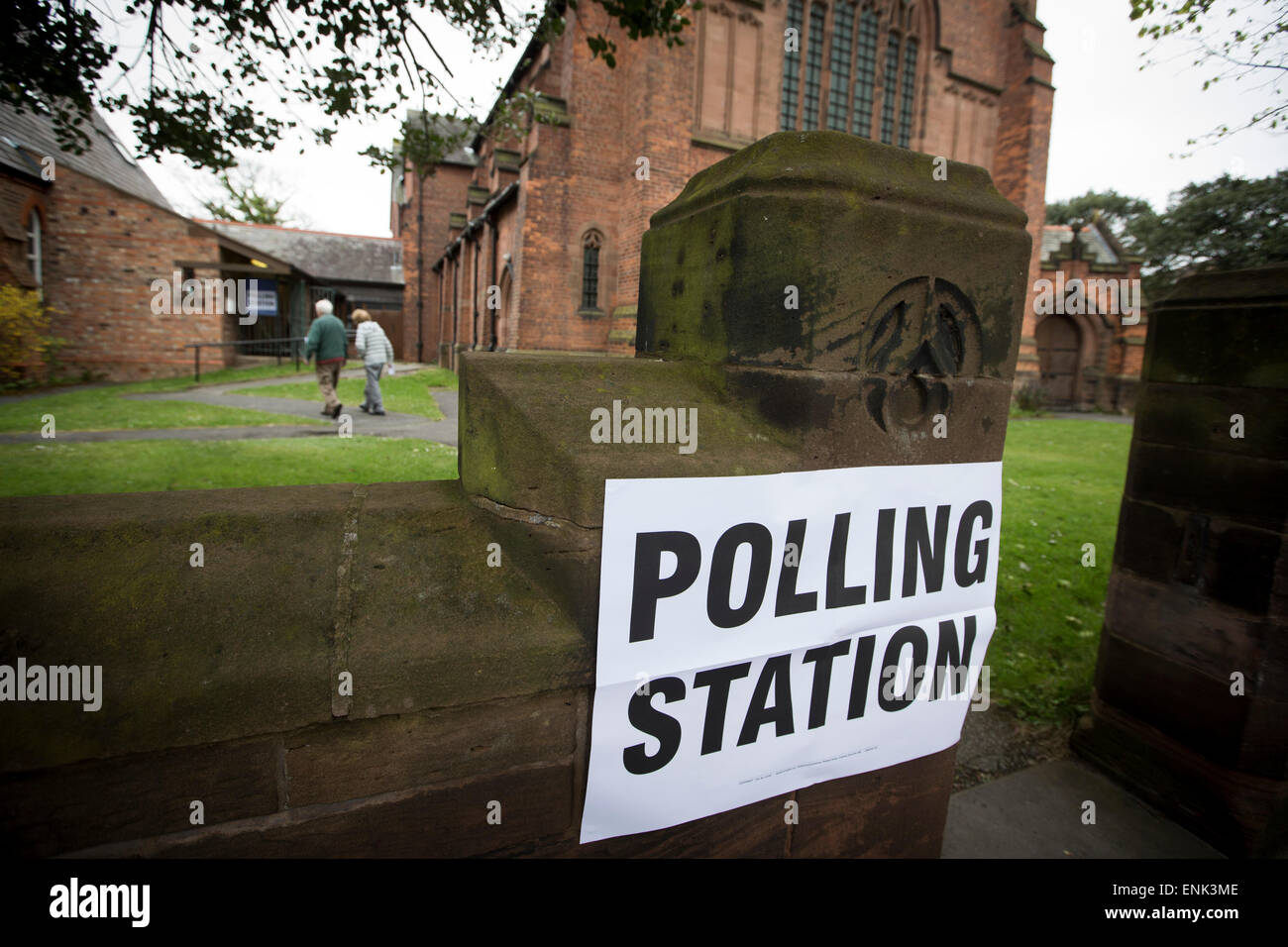 Voters arriving at a polling station in Hoylake, Wirral to cast their votes at the 2015 UK General Election. They - Stock Image