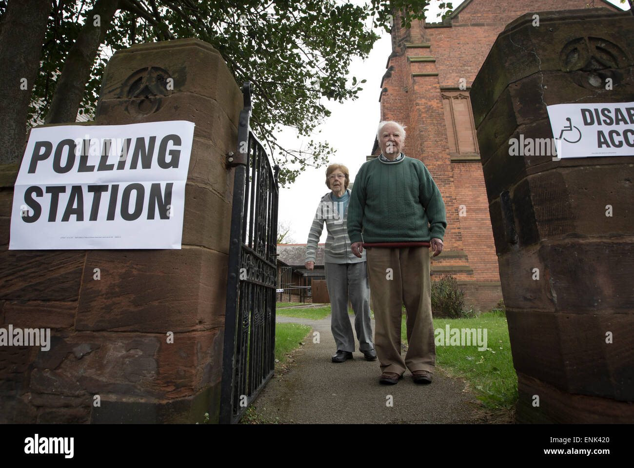 Voters leaving a polling station in Hoylake, Wirral to cast their votes at the 2015 UK General Election. They were - Stock Image