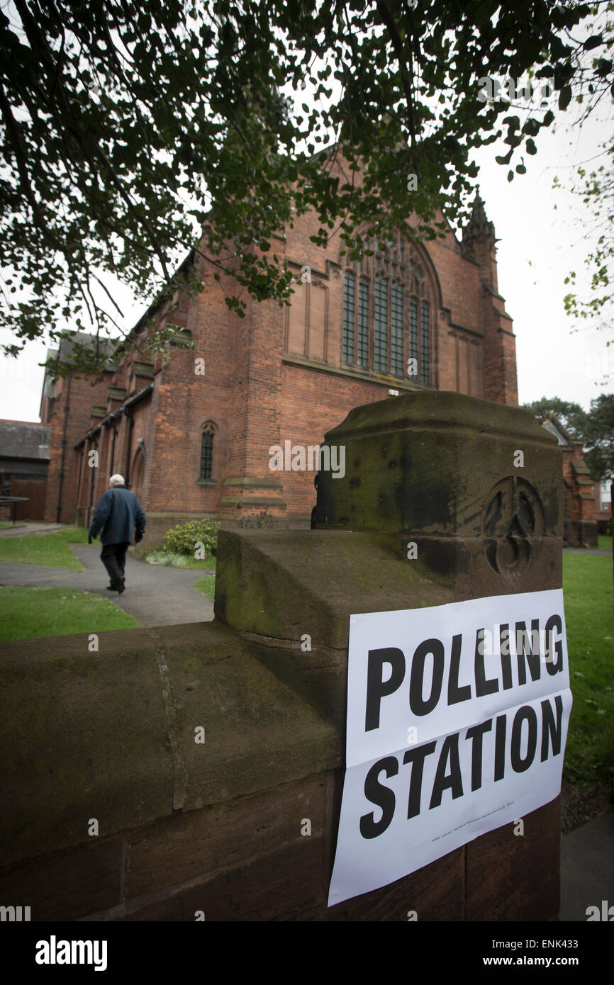 A voter arriving at a polling station in Hoylake, Wirral to cast his vote at the 2015 UK General Election. He was - Stock Image