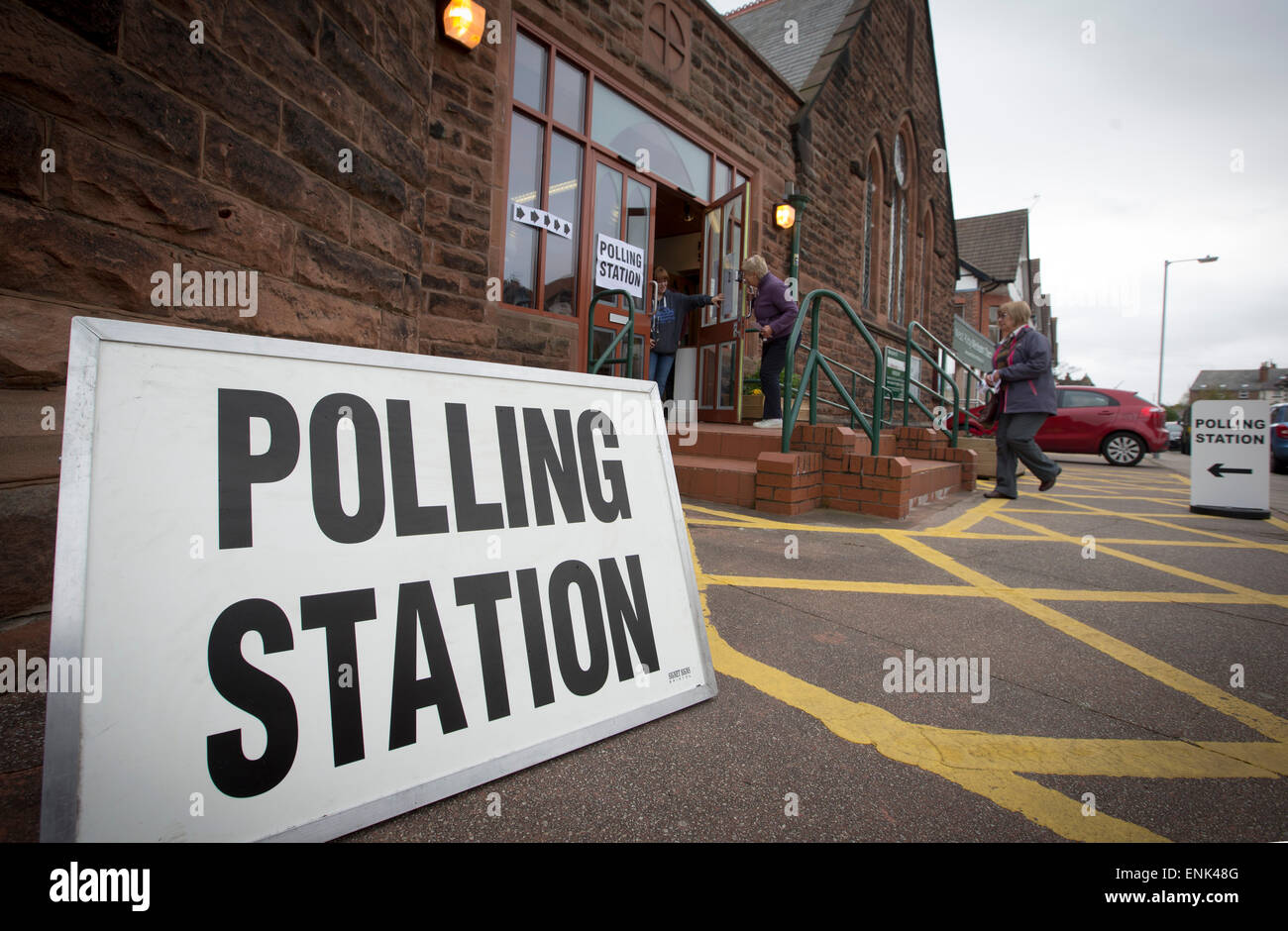Voters arriving at a polling station in West Kirby, Wirral to cast their votes at the 2015 UK General Election. - Stock Image