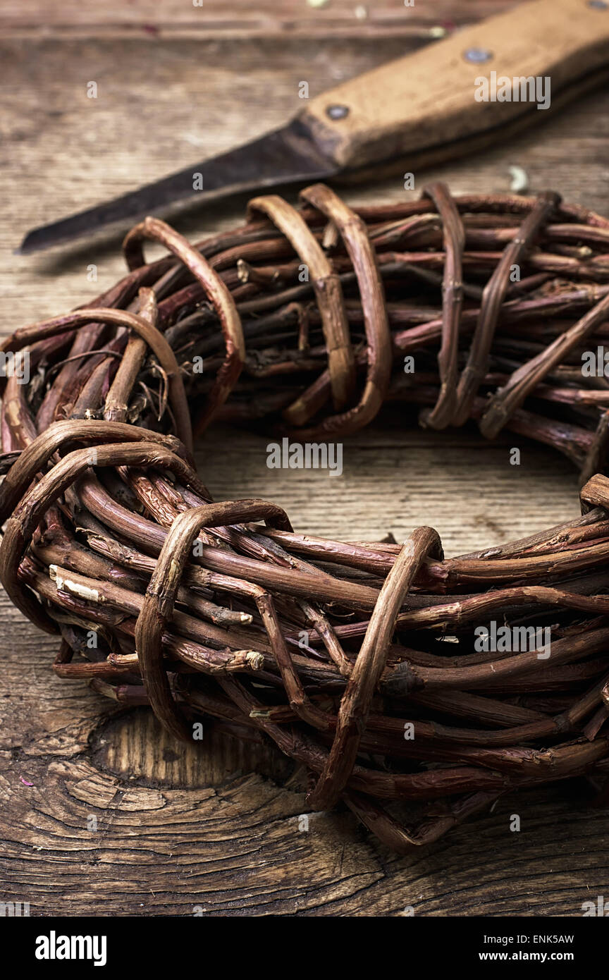 medicinal licorice rolled in  coil on wooden background.Selective focus - Stock Image